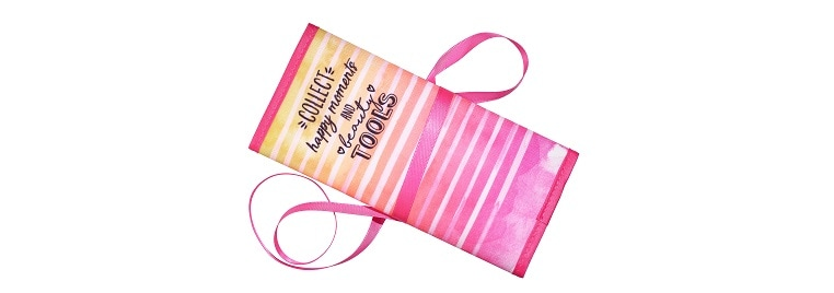 essence hello happiness brush bag front